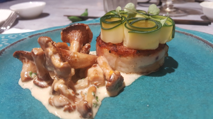 Pan-fried Scallop Mousse Wrapped with Lardon, Topped with Zucchini Curls, Chanterelle Mushrooms